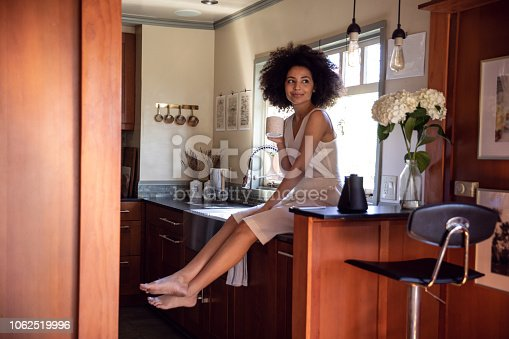 istock Young woman spending a relaxing day in her beautiful home 1062519996