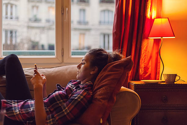 young woman spending the weekend at home - laziness stock photos and pictures