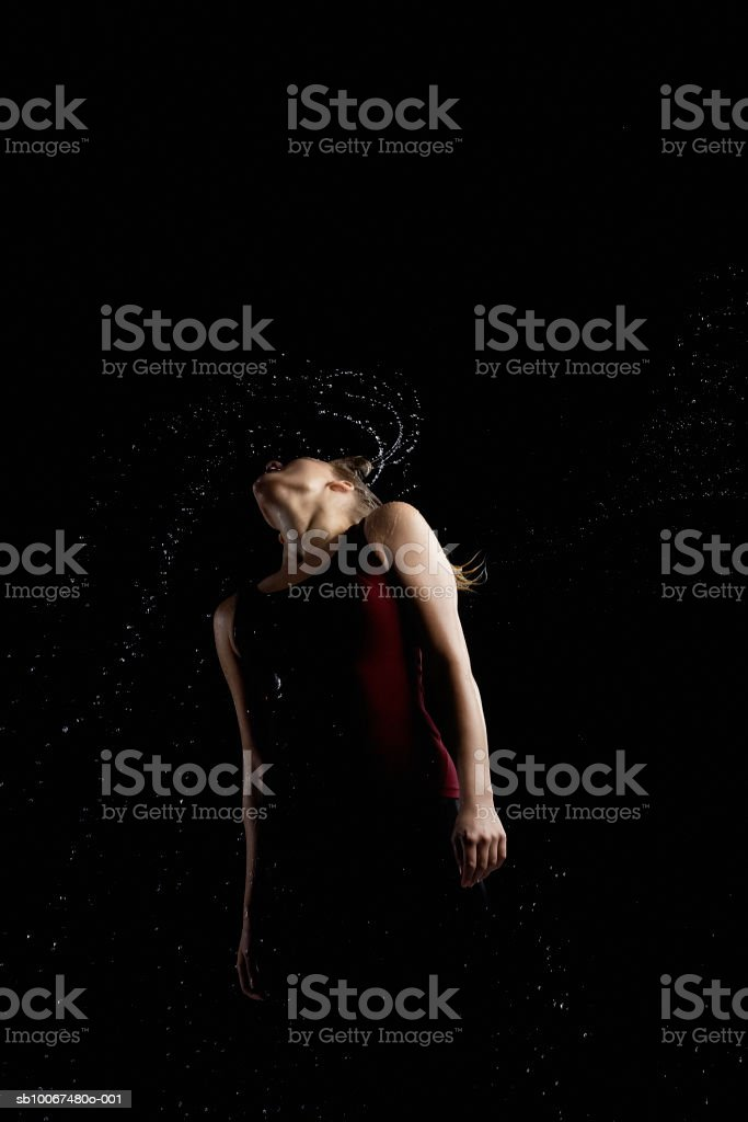 Young woman spraying water out from hair royalty-free stock photo
