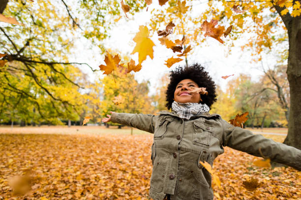 Young woman spreading her arms wide stock photo