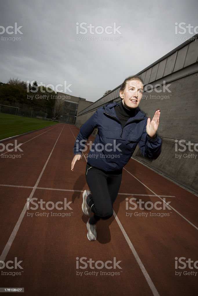 Young Woman Sprinting royalty-free stock photo