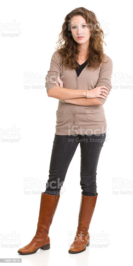 Young woman standing and looking at camera with arms crossed stock photo
