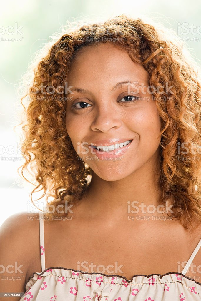 Young Woman Standing and Smiling stock photo