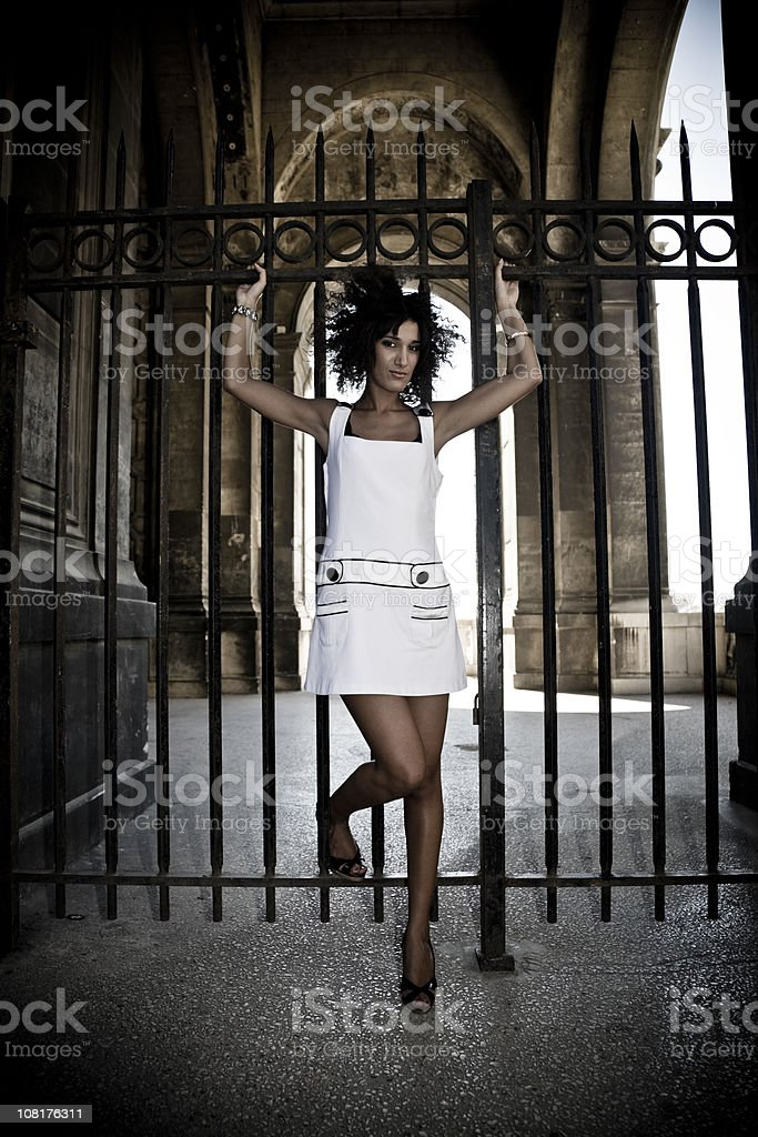 Young Woman Standing at Gate to Palais Longchamp in Marseille stock photo