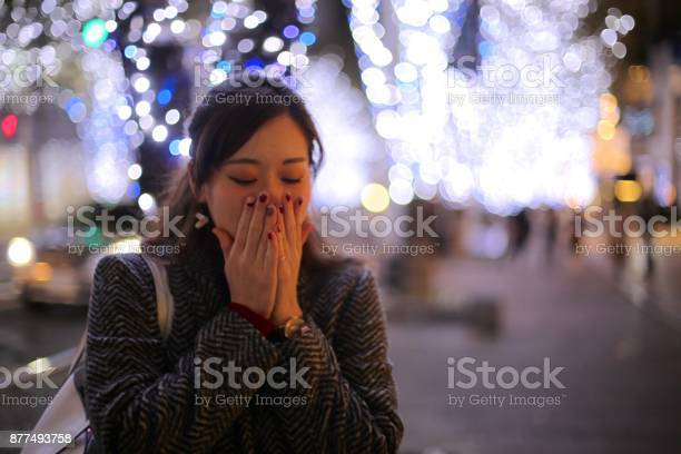 Young woman standing at street decolatd with christmas lights picture id877493758?b=1&k=6&m=877493758&s=612x612&h=nymn171i6p7as skhwtvxfrxg weydp4 u5gibdubqk=