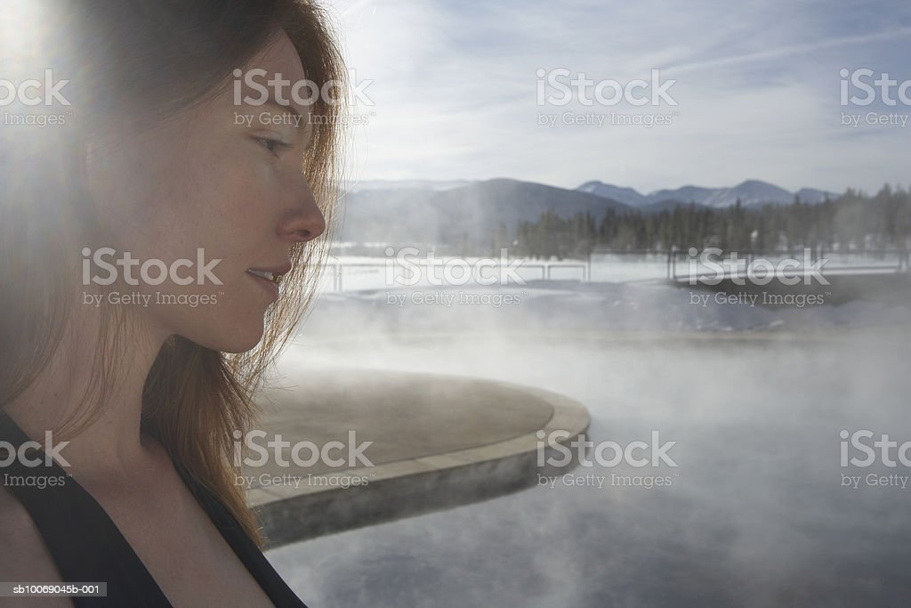 Young woman standing by swimming pool royalty-free stock photo