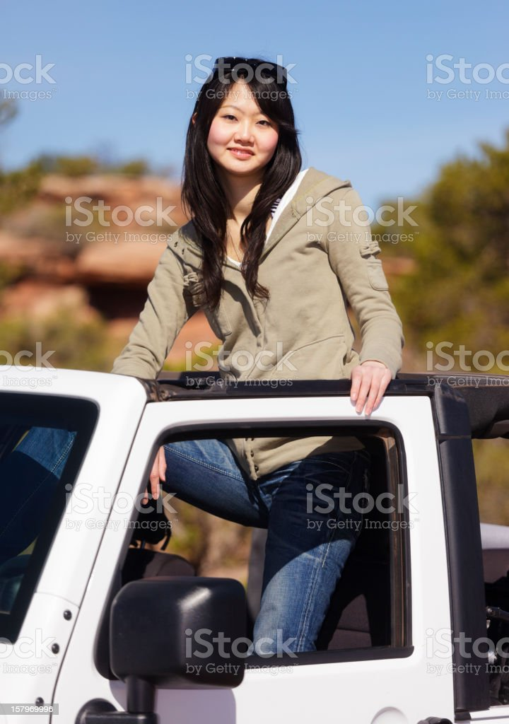 Young Woman Standing in an Off Road Vehicle royalty-free stock photo