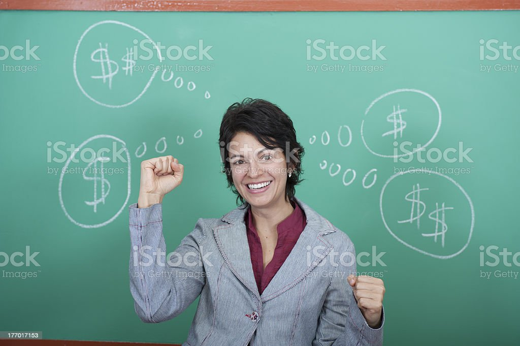 Young woman standing in front of blackboard royalty-free stock photo