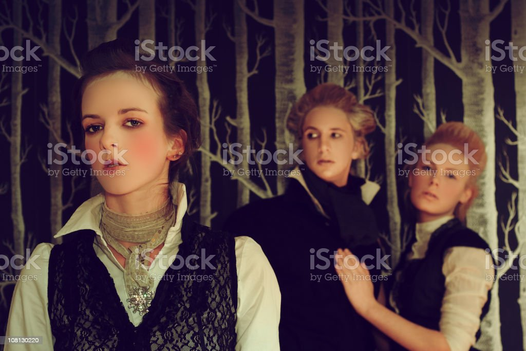Young Woman Standing in Front of Couple, Victorian Style royalty-free stock photo