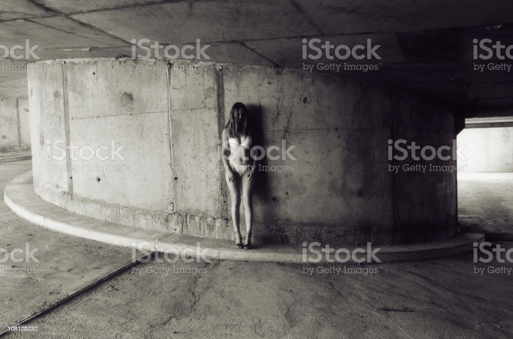 Young Woman Standing in Parking Garage, Black and White royalty-free stock photo