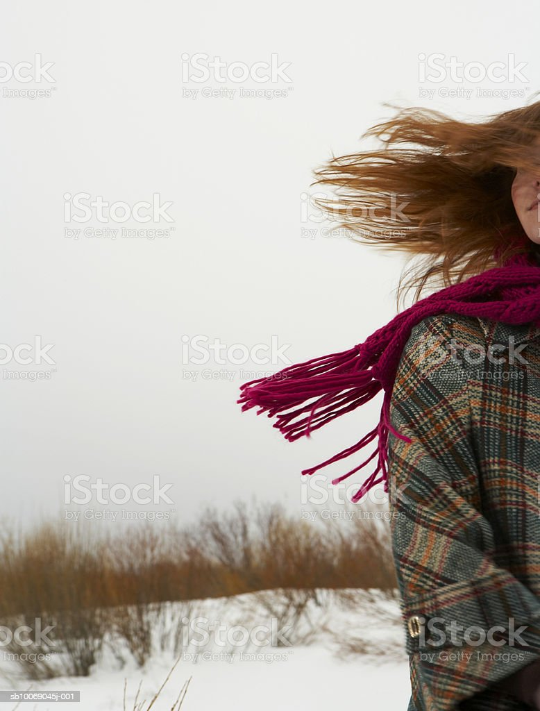 Young woman standing in snow royalty-free stock photo