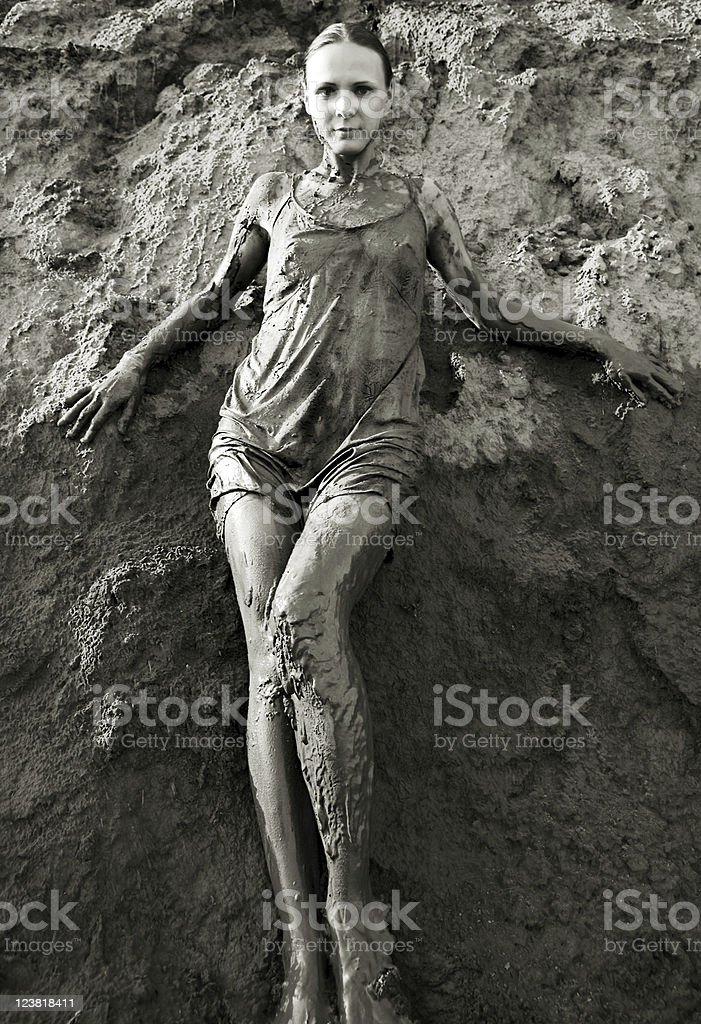 Young woman standing in the mud royalty-free stock photo
