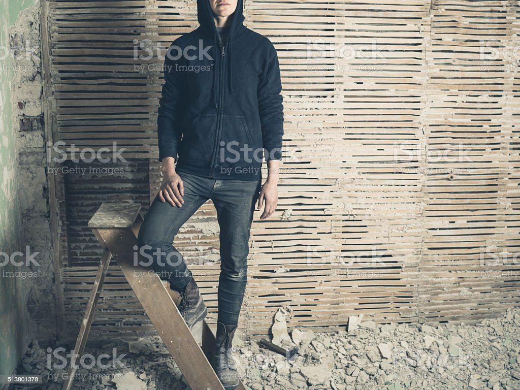 Young woman standing on a stepladder stock photo