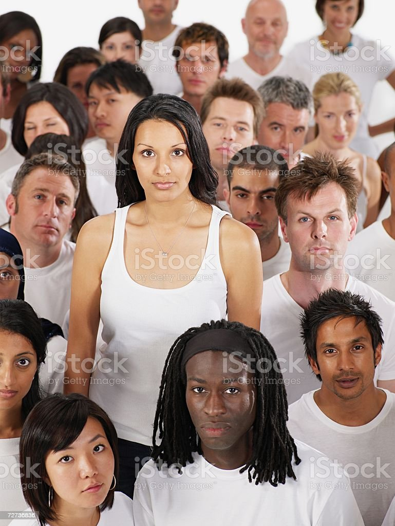 Young woman standing out from the crowd royalty-free stock photo