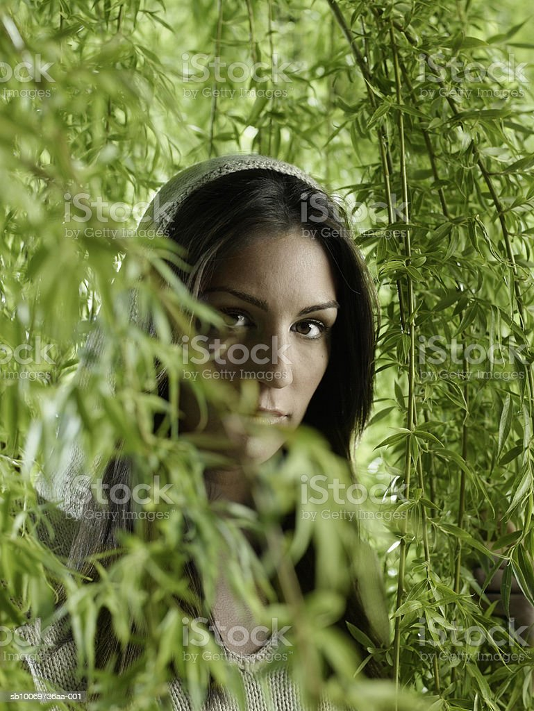 Young woman standing with creepers, portrait, close-up royalty-free stock photo