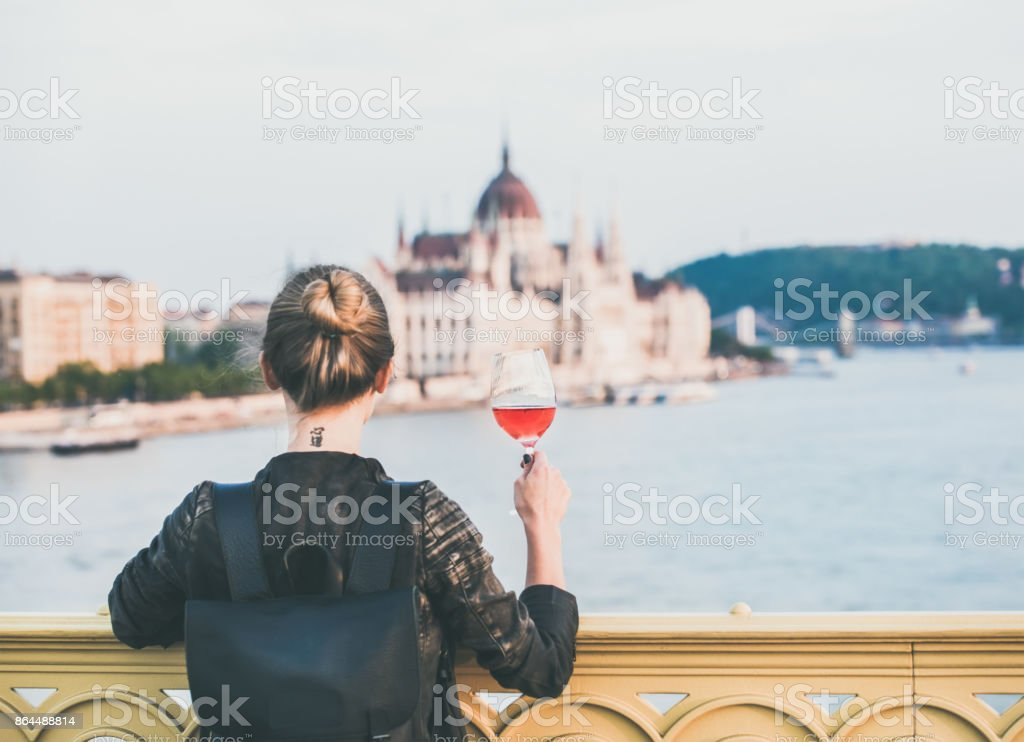 Young woman standing with glass of rose wine in Budapest stock photo