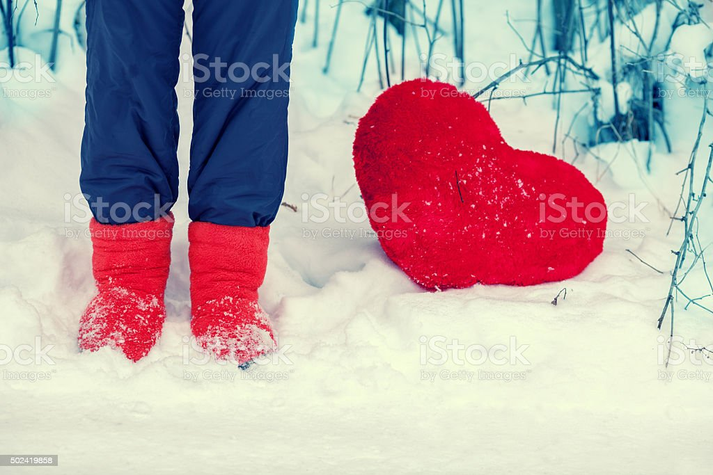 Young woman staying in the snow stock photo