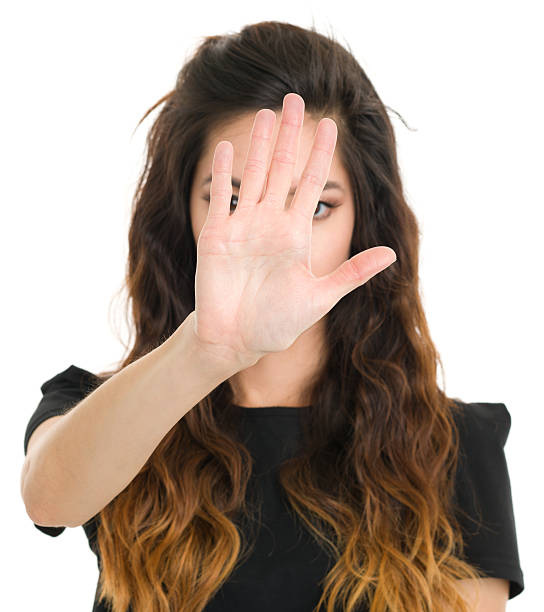 Young Woman Stop Hand Gesture stock photo