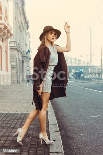 529664088istockphoto young woman street 669338954