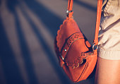 Young woman street style leather purse