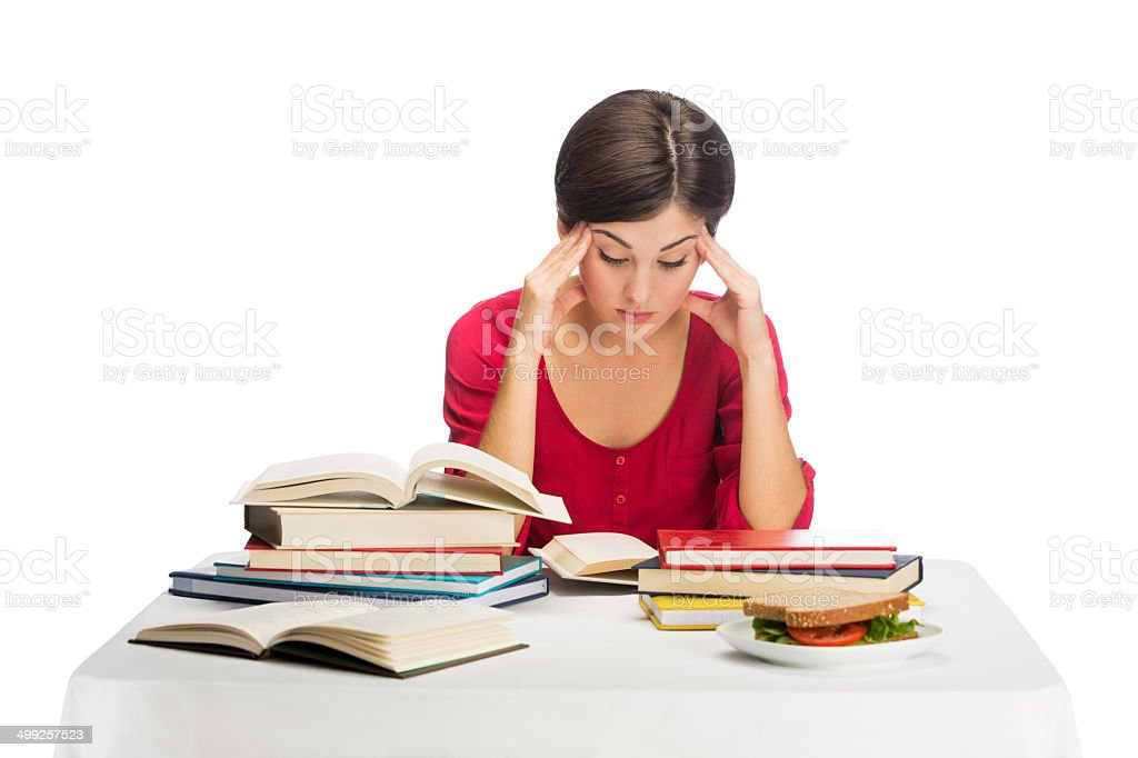 Young woman stressed with homework royalty-free stock photo