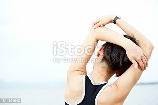 istock young woman stretching arms before exercising 814191640
