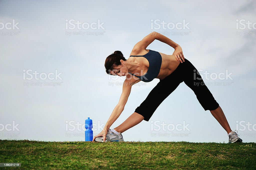 Young Woman Stretching Before Jogging royalty-free stock photo