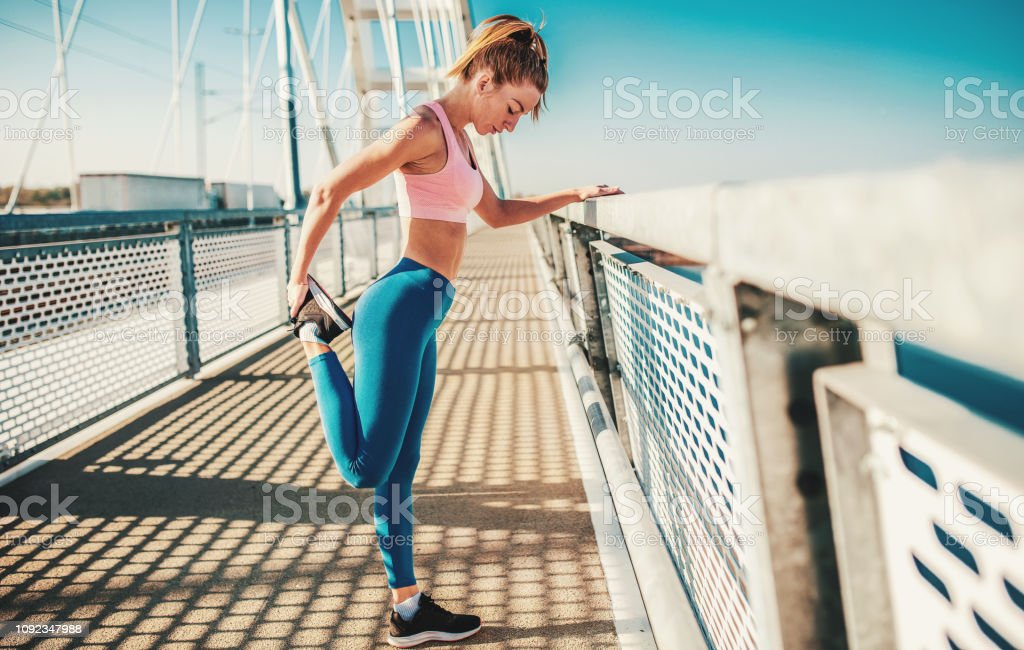 Young woman stretching body after training. Fitness, sport, lifestyle concept stock photo