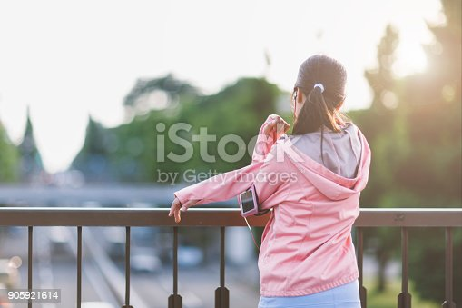 istock Young Woman Stretching Her Arms 905921614