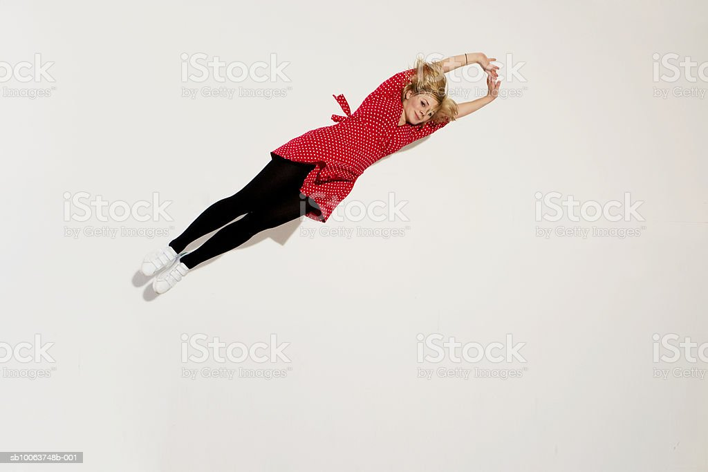 Young woman stretching on white background royalty-free 스톡 사진