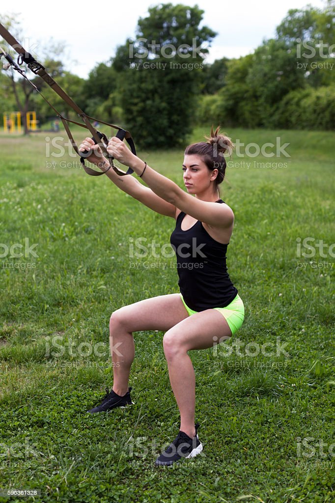 Young Woman Stretching Outdoors royalty-free stock photo