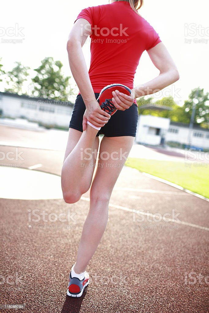 Young woman stretching royalty-free stock photo