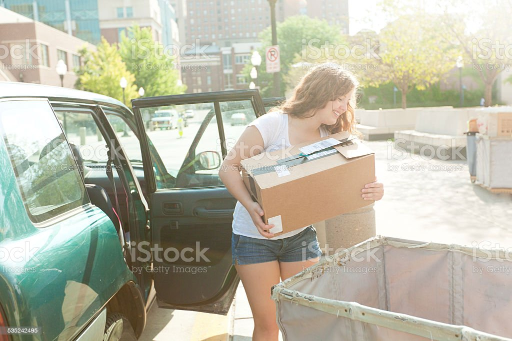 Young Woman Student Moving Dormitory on University Campus stock photo