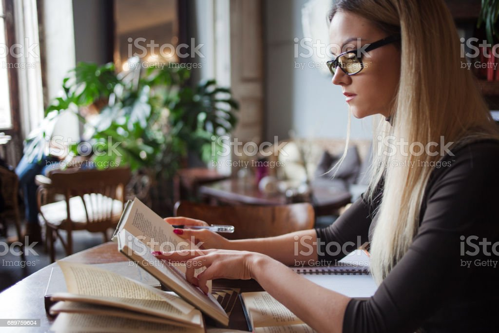 Young woman student of the University. Preparing exam and learning...
