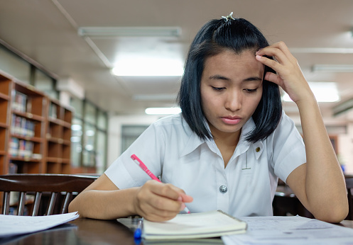 istock young woman student reading a book with stress 531772470