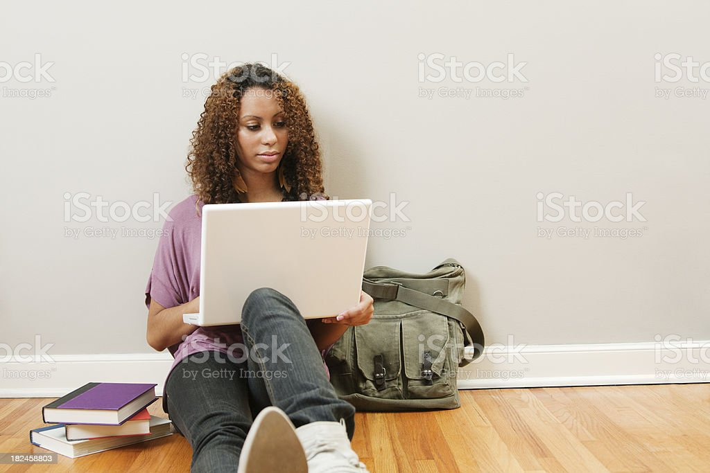 Young Woman Student Studying in the Hallway Vt royalty-free stock photo