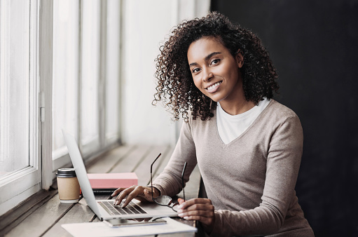 Woman working on laptop computer at home. Online shopping, work from home, student lifestyle,  freelance, online learning, studying concept. Distance education