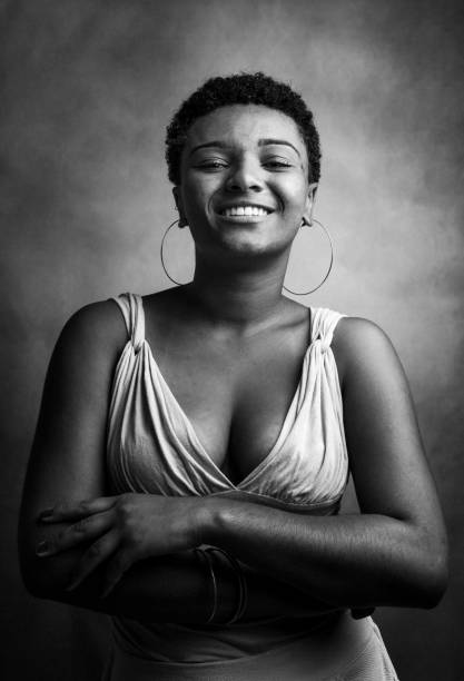 Young woman studio portrait Portrait of a young brazilian black woman in studio. spaghetti straps stock pictures, royalty-free photos & images
