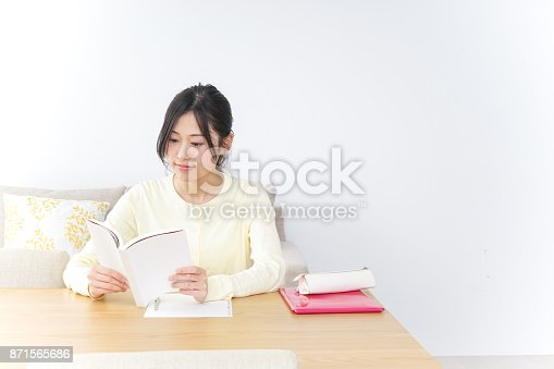 istock Young woman study at home 871565686