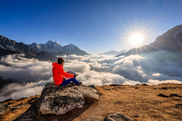 Young woman studying map in Mount Everest National Park, Nepal stock photo