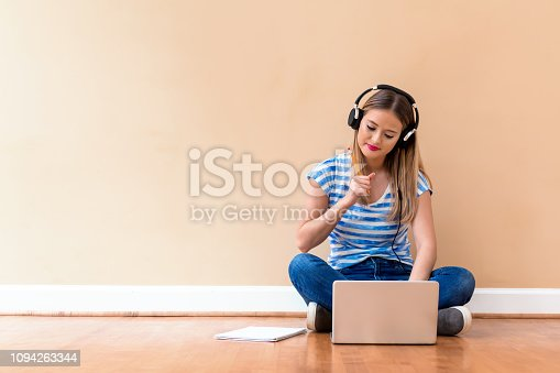 istock Young woman studying on her laptop computer 1094263344