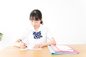 istock Young woman studying 1097893894