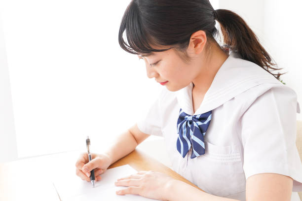 Young woman studying Young woman studying japanese school girl stock pictures, royalty-free photos & images