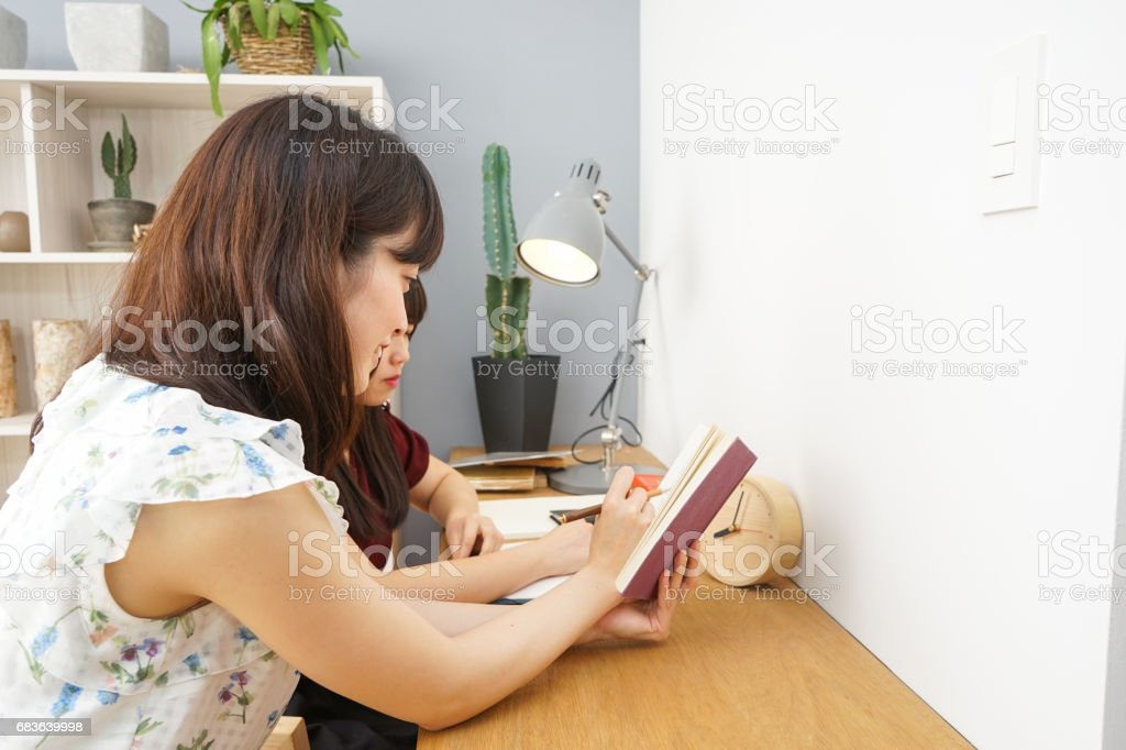 Young woman studying with her teacher stock photo