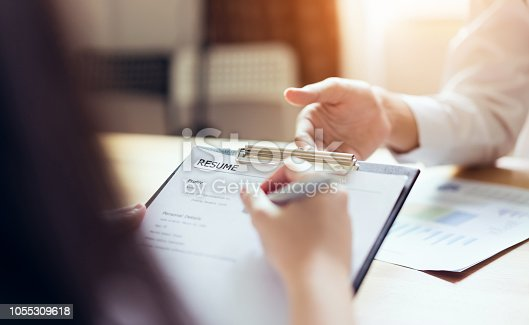 istock Young woman submit resume employer to review job application. Concept presents ability for the company to agree with position of the job. 1055309618