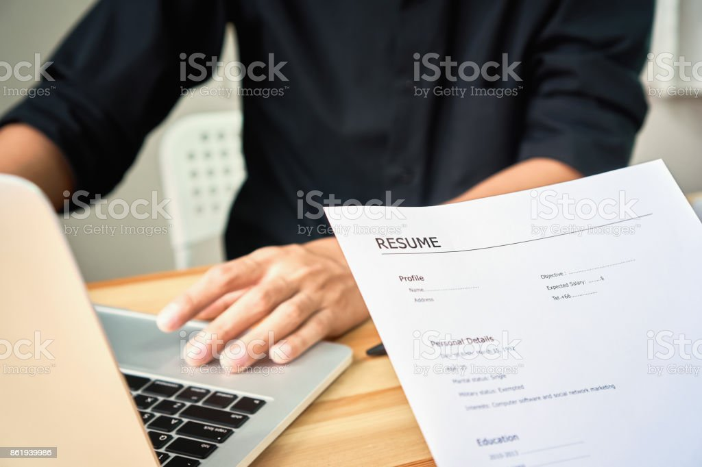 Young woman submit resume to employer to review job application. The...