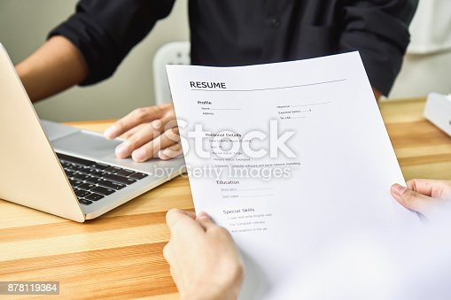 istock Young woman submit resume to employer to review job application. The concept presents the ability for the company to agree with the position of the job. 878119364
