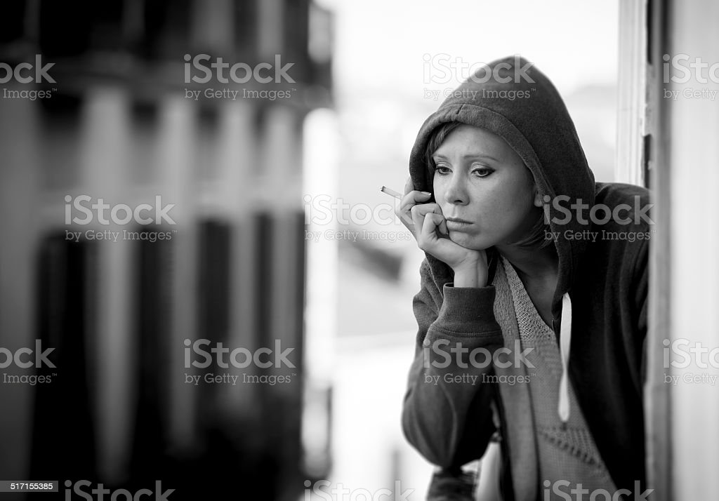 young woman suffering depression and stress outdoors at the balc stock photo