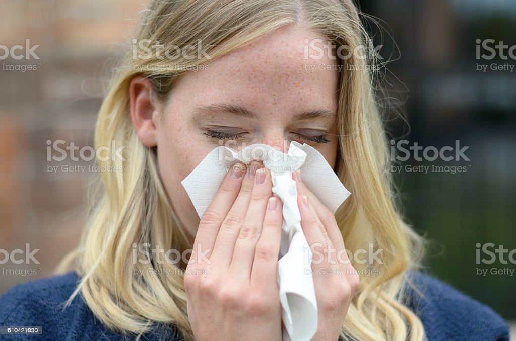 Young woman suffering from a seasonal cold stock photo