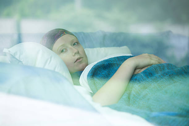 Young woman suffering from cancer Young woman in bed suffering from cancer chemotherapy cancer stock pictures, royalty-free photos & images